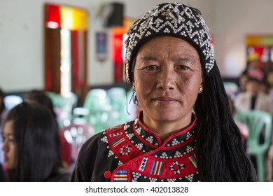 KENGTUNG, MYANMAR - JANUARY 22, 2016: Colourful tribeswoman at Kengtung Market in Myanmar.