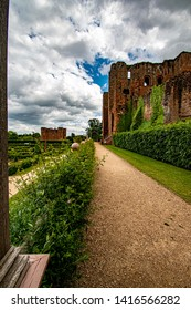 Kenilworth/England June 4th 2019 Kenilworth castle Elizabethan gardens  in full bloom with flowers and  statures against the castle backdrop