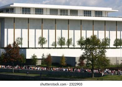 Kennedy Center in Washington DC with marathon runners