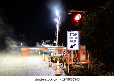 Kennedy Hill, Canada - December 11, 2020:View of sign Stop Here On Red due to A major upgrade to Highway 4 at Kennedy Hill northeast of the Tofino-Ucluelet Highway 4 junction.