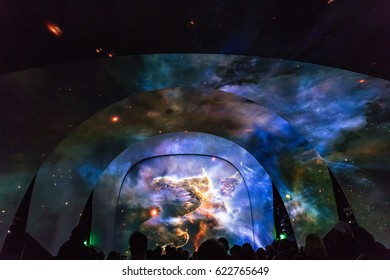 KENNEDY SPACE CENTER, FLORIDA, USA - SEBRUARY 19, 2017: Preliminary projections at the entrance to Kennedy Space Center. Space Shuttle Atlantis at the visitor complex of Kennedy Space Center.
