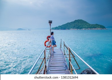 Kennedy Town, Victoria Rd., Hong Kong - September 2017 - Tourist and Photographer at Sai Wan Swimming Shed located in Kennedy town with offshore step into the sea. One of landscape Destination in HK.