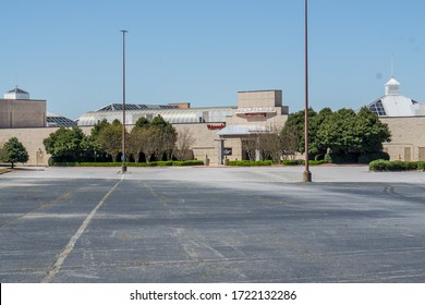 Kennesaw, GA / USA - 04/03/20: Empty parking lots - temporary shut down at Cobb county Town Center mall due to economic crisis during Covid-19 Corona Virus Pandemic.