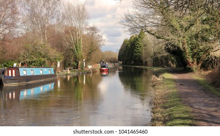 Kennet & Avon Canal in west Berkshire with moored Narrowboats on the riverbank