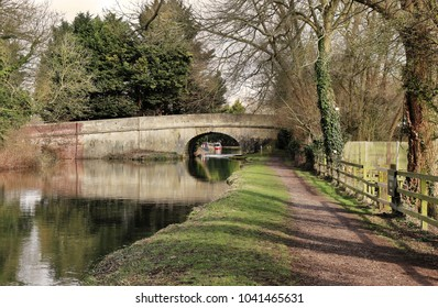 Kennet & Avon Canal in west Berkshire with quaint stone road bridge crossing the canal