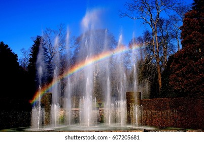 Kennett Square, Pennsylvania - December 31, 2011:  A rainbow over the 229 water jets comprising the spectacular 1931 Main Fountain Garden at Longwood Gardens