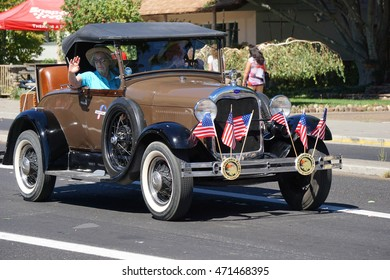 KENNEWICK, WA - AUGUST 20, 2016:Classic automobile with flags during Benton Franklin County Fair Parade