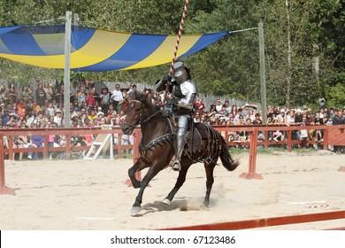 KENOSHA, WI - SEPTEMBER 4: An actor as medieval knight demonstrate skills on horseback at the annual Bristol Renaissance Faire on September 4, 2010 in Kenosha, WI