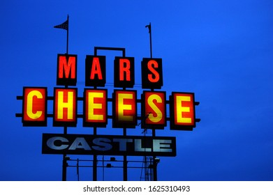 Kenosha, WI, USA November 6 A sign for Mars Cheese, one of several specialty cheese shops in the state, brightens the night sky in Kenosha, Wisconsin