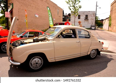 Kenosha, Wisconsin / USA - August 31, 2019:  A mid 1960 Saab 96 Deluxe 4 in beige on display at the annual downtown Kenosha car show.