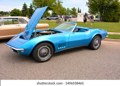 Kenosha, Wisconsin / USA - August 31, 2019:  A blue C3 Corvette convertible with the top down and hood open at the annual Kenosha downtown car show.  The C3 style includes years 1968 through 1972.