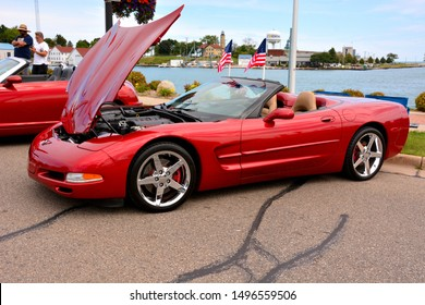 Kenosha, Wisconsin / USA - August 31, 2019: A beautiful metallic red C5 Chevrolet Corvette Convertible with tan interior and the top down.  The C5 Corvette style includes 1997 through 2004.