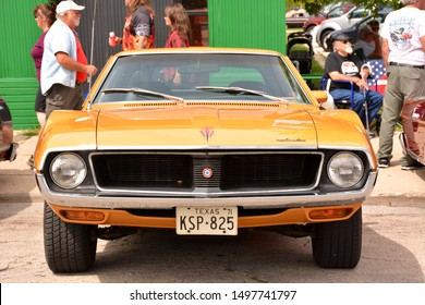 Kenosha, Wisconsin / USA - August 31, 2019:  A front view of an orange color 1971 AMC Javelin on display at the local downtown Kenosha car show.