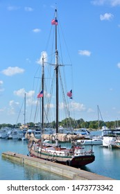 Kenosha, Wisconsin / USA - August 5, 2019: The tall ship Red Which at home port in Kenosha moored to its dock on a beautiful summer day.