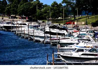 Kenosha, Wisconsin / USA - July 15, 2019:  Looking north at the Kenosha Harbor with rows of vessels on the east side of the open water.