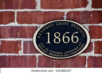 Kenosha, Wisconsin / USA - July 15, 2019:  The 1866 sign plaque attached to the Kenosha Light Station on the red brick portion of the light keeper's house.
