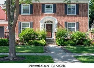 Kenosha, Wisconsin/USA – JULY 08 2018 - front entrance of colonial style home in affluent neighborhood