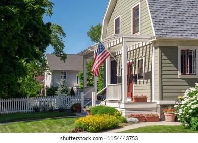 Kenosha, Wisconsin/USA - July, 2018. Patriotic home with US flag and pergola front porch