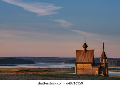 Kenozero Lake,Kenozersky National Park.Russian Traditional Wooden Church (Chapel)  Of St.Nicholas On The Top Of Hill In The Vershinino Village Against The Background Of Beautiful Sky And Vast Expanses