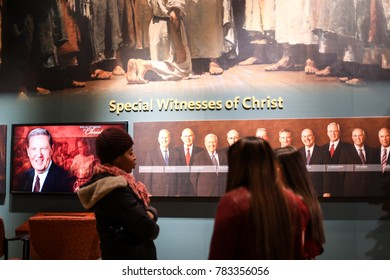 Kensington, MD - December 25, 2017: Two Mormon girls attempt to recruit a visitor to their religion at the Washington DC Temple of The Church of Jesus Christ of Latter-day Saints (LDS Church).
