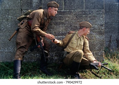 Kent England 2016 Re-enactors  wear uniforms of WW2 and carry PPSH and PPS machine guns image taken at Military Odyssey 2016