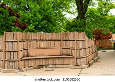 "KENT, OH - MAY 21, 2018: The secluded ""Brain Plaza"" on the KSU campus features stone benches embedded in carved shelves of books and a sculpture of a giant brain."