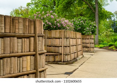 "KENT, OH - MAY 21, 2018: These old library books, carved in stone, are part of the secluded and peaceful ""Brain Plaza"" on the campus of Kent State University in Northeast Ohio."