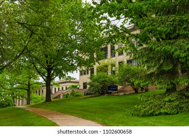 "KENT, OH - MAY 21, 2018: Merrill Hall and the adjoining Lowry Hall (left) are bastions of the venerable ""Front Campus,"" the oldest and shadiest part of the KSU grounds."