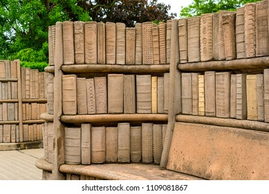 "KENT, OH - MAY 21, 2018: Outdoor stone benches, with carved shelves full of old books, are part of the secluded and peaceful ""Brain Plaza"" on the campus of Kent State University in Northeast"