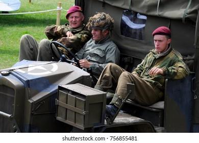 Kent, UK - 07/27/17: Re-enactors in cab of Morris Commercial C8 FAT at 2017 War and Peace Revival at Hop Farm near Paddock Wood.