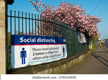 Kent, UK. 11th April 2020. Large banner attached to railings, warning the general public to keep to the social distancing rules whilst using the public parks, in the London Borough of Bexley.