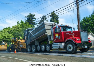 Kent, WA, USA May 05, 2016: Crews work to repave a local residential street