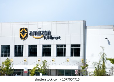 KENT, WASHINGTON/USA - April 24, 2018: Close up on the sign at an Amazon Fulfillment Center and package distribution warehouse, with space for text on top
