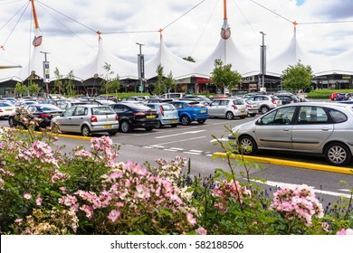 KENT,ENGLAND-AUGUST 4,2016: Ashford Designer Outlet, where shoppers can buy brand name items, is quite crowded and popular in summer.