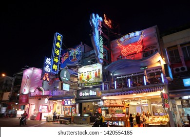 KENTING, TAIWAN - NOVEMBER 27, 2018: People visit Kenting Street Night Market in Taiwan. Night food markets are a big part of Taiwanese culture.