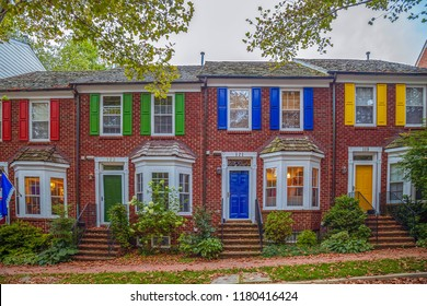 Kentlands, Gaithersburg, Maryland, USA - August 31, 2018: Beautiful and multicolored American houses at dusk time.