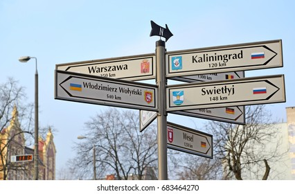 """KENTShIN, POLAND - JANUARY 02, 2014: The index of distances and the directions to the cities of Russia, Ukraine, Germany. Polish text """"Kaliningrad, Light, Vladimir Volynsky, Warsaw, Vesel"""""""