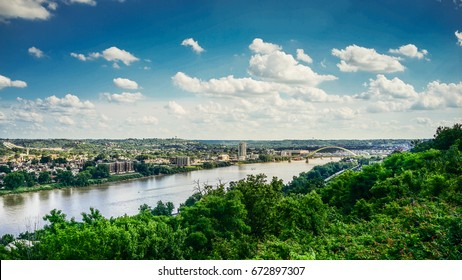 Kentucky and Ohio River with blue sky and clouds