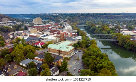 The Kentucky River meanders along framing the downtown urban core of Frankfort KY - Shutterstock ID 1581227710
