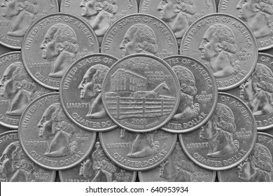 Kentucky State and coins of USA. Pile of the US quarter coins with George Washington and on the top a quarter of Kentucky State.