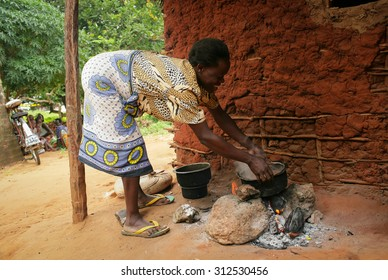 Kenya 2015 Year January 28 .African kitchen . Black woman cooking dinner