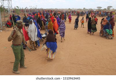Kenya, Africa: August 13, 2019 - A group of Somali women run after security forces hit them for refusing to disperse at a rally inside the Dadaab Refugee Camp.