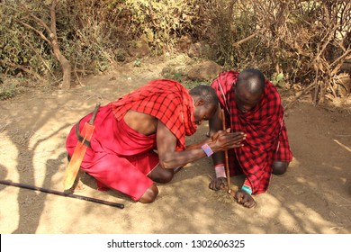 KENYA, AMBOSELI NATIONAL PARK - AUGUST 04, 2018 - Two Maasai men show traditional fire making