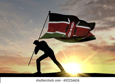 Kenya flag being pushed into the ground by a male silhouette. 3D Rendering
