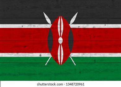 Kenya flag painted on old wood plank. Patriotic background. National flag of Kenya