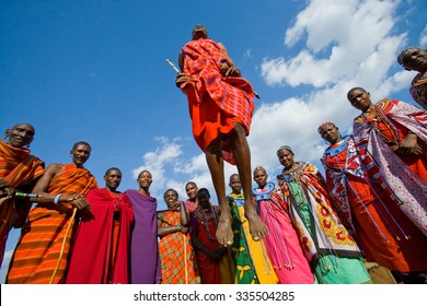 KENYA, MASAI MARA - JULY 19, 2011: Masai women are standing at the gates of Masai village. Kenya, Masai Mara, July 19, 2011