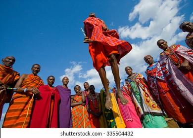 KENYA, MASAI MARA - JULY 19, 2011: Masai women are standing at the gates of Masai village. Kenya, Masai Mara, July 19, 2011