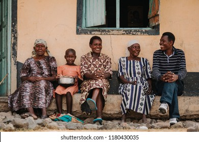 KENYA, RUSINGA island, UTAJO village - FEBRUARY 15, 2015: women and a man talking