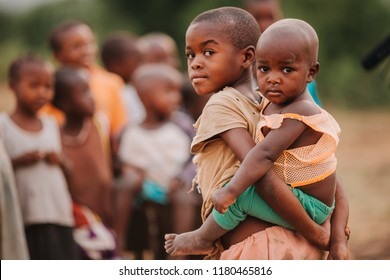 KENYA, RUSINGA island, UTAJO village - FEBRUARY 15, 2015: portraits from Africa, Kenya, mother and her child