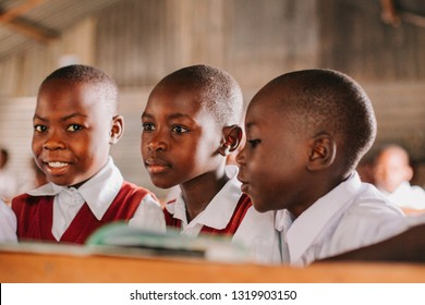 KENYA, RUSINGA island, UTAJO village - FEBRUARY 21, 2015: children in a poor african class, school